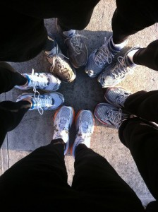 5 people in running shoes