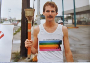 Man Holding the Olympic Torch