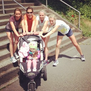 women pushing jogging stroller
