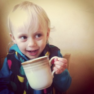 kid posing with coffee cup