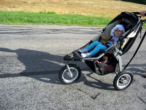 kid in jogging stroller