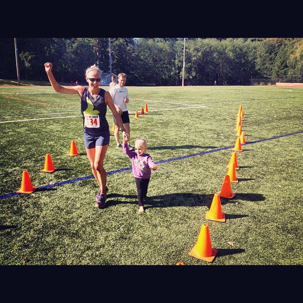 mom and daughter finishing race together