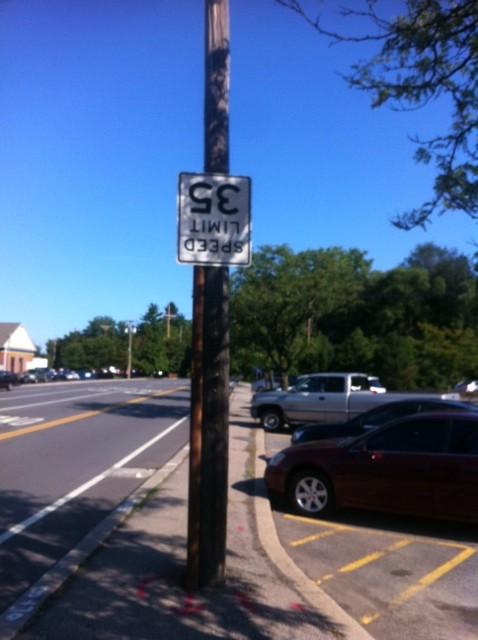 upside down road sign