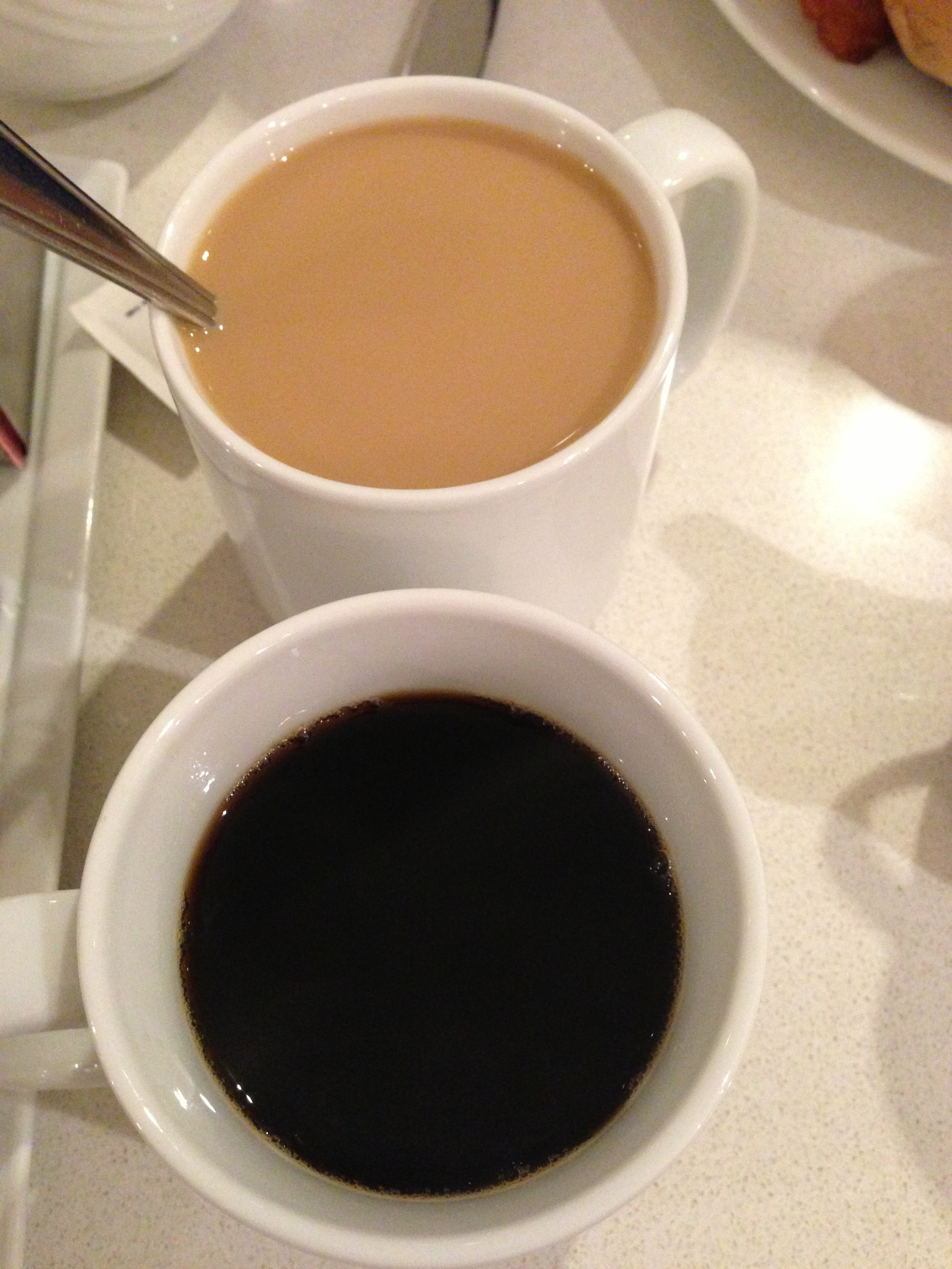 black coffee and creamer coffee